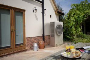 A Dimplex air source heat pump installed outside a domestic property