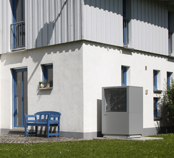 The LA-TU air source heat pump installed outside an industrial building