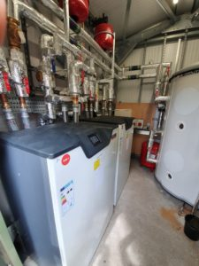 Inside the plant room of the heat pump heating project in Suffolk